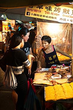 Vendor and customers, food stall, Shilin Night Market, Taipei, Taiwan, Asia