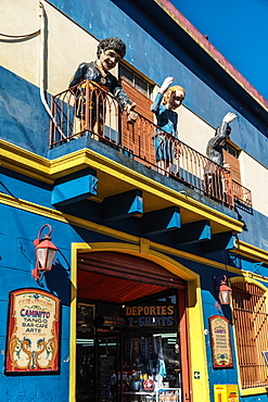 Balcony over bar on El Caminito with statues of Maradona, Evita and Gardel, a tango singer, La Boca, Buenos Aires, Argentina, South America