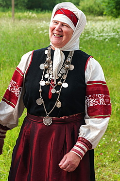 Mature Seto woman, singing polyphonically at Feast Day of St. Peter and St. Paul, Uusvada, Setomaa, SE Estonia, Europe