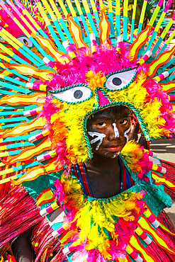 Participant in flamboyant dress, eyes matching those on his costume, at the annual Ati-Atihan Festival, Kalibo Island, Philippines, Southeast Asia, Asia