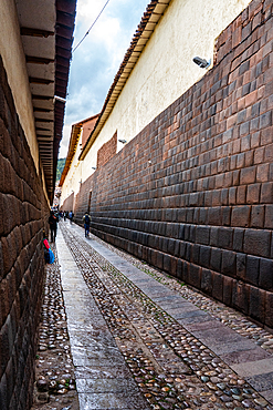 Long view of the precision-built, mortar-less Incan masonry of Loreto Street, Cusco, UNESCO World Heritage Site, Peru, South America