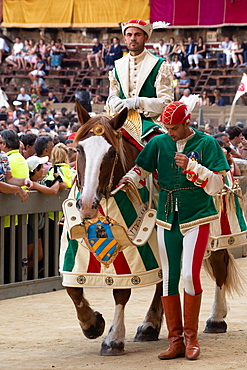 At the pageant that precedes the Palio race, representatives and riders of each neighbourhood parade in traditional costume, Siena, Tuscany, Italy, Europe
