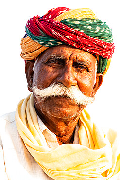 Distinguished senior horse trader with remarkable moustache and brightly multi-coloured turban, at the annual Chandrabhaga Fair, Rajasthan, India, Asia