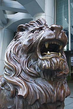 Bronze lion statue outside the HSBC Bank Headquarters, rubbing its paws is said to bring good luck, Central, Hong Kong, China, Asia