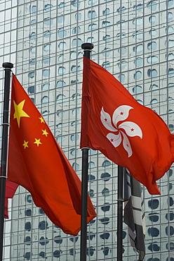 The Hong Kong and Chinese flags fly in Central, Hong Kong, China, Asia