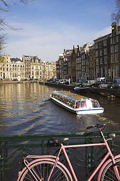 Tourist canal boat on the Herengracht canal, Amsterdam, Netherlands, Europe