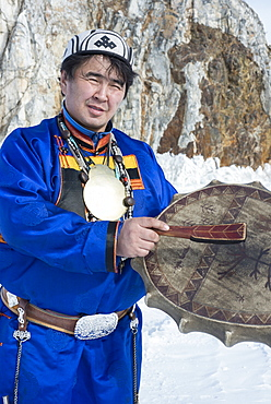 Hereditary Buryat shaman, Valentin Khagdaev with skin covered drum at Olkhon Island celebrating the spirit of Baikal on the ice, Lake Baikal, Irkutsk Oblast, Siberia, Russia, Eurasia