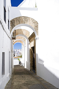 Arched architecture in the narrow lanes of the picturesque village of Vejer de la Frontera, Andalucia, Spain, Europe