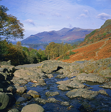 Ashness Bridge over river running into Derwent Water, with Skiddaw behind, Lake District National Park, Cumbria, England, United Kingdom, Europe