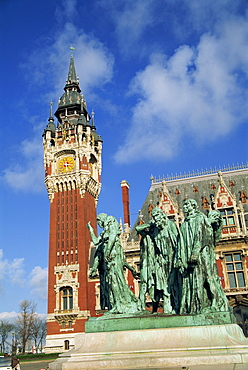 Monument to the burghers of Calais by Rodin, and the Hotel de Ville in Calais, Nord Pas de Calais, France, Europe