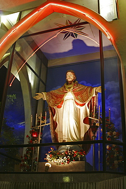 Christian shrine of Jesus on roadside near Colombo at night, Sri Lanka, Asia