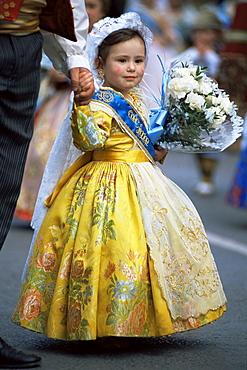 Little girl in procession of Falleros during Las Fallas Fiesta, Valencia, Spain, Europe