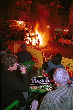 Valencia - Spain - Las Fallas Fiesta - Having a drink whilst watching a small ninot burn