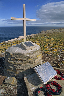 Poppy wreaths laid on the 1982 War Memorial to the dead of HMS Sheffield on Sealion Island in the Falkland Islands, South America