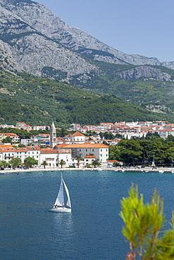 Makarska harbour with yacht and mountains behind, Dalmatian Coast, Croatia, Europe