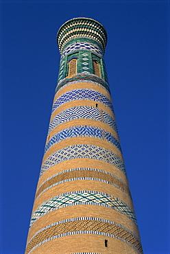 Architectural details of bricks and tiles on the Islom-Huja minaret in Khiva, Uzbekistan, Central Asia, Asia