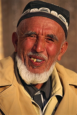 Portrait of an old Uzbek man with crooked and metal teeth smiling, in Khiva, Uzbekistan, Central Asia, Asia