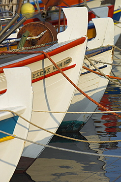 Close up of the front of three fishing boats in the harbour, Sitia, Crete, Greek Islands, Greece, Europe