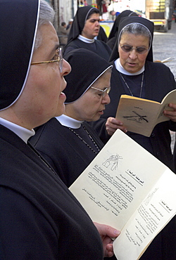 Group of Palestinian nuns praying on Good Friday at the Third Station of the Cross, Via Dolorosa, Old City, Jerusalem, Israel, Middle East