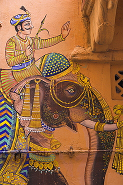 Typical house decorated with Mewar folk art of man riding elephant, Jagdish Mandir area, old city, Udaipur, Rajasthan state, India, Asia