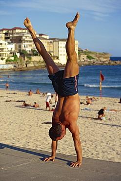 Acrobat on promenade, Bondi Beach, Sydney, New South Wales, Australia, Pacific
