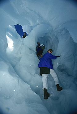 Climbing through tunnels of ice, Fox Glacier, South Island, New Zealand, Pacific