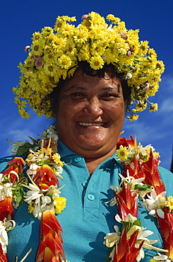 Woman arrives by plane adorned with flowers, Rarotonga, Cook Islands, Pacific