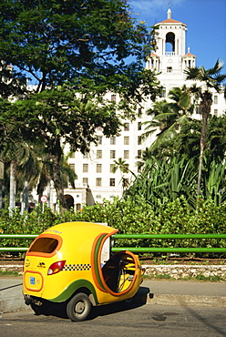 Yellow tuk tuk taxi and Hotel Nacional, Havana, Cuba, West Indies, Central America