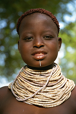 Young girl with henna in hair and wearing beads and nail, Omo camp, Murulle, Ethiopia, Africa