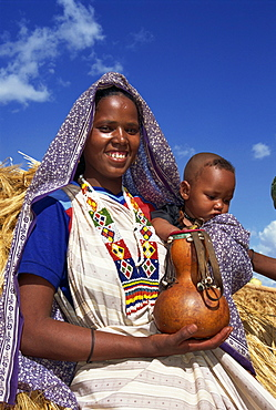 Mother holding baby and gourd, Ethiopia, Africa