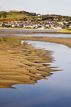 Exposed rippled sandbank on Conwy River estuary at low tide, with Deganwy beyond, Conwy, Wales, United Kingdom, Europe