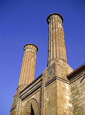 Twin minarets of Cifte Minare Medresse, Erzurum, Anatolia, Turkey, Asia Minor, Eurasia