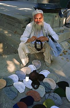 Man knitting woollen caps, Istanbul, Turkey, Europe