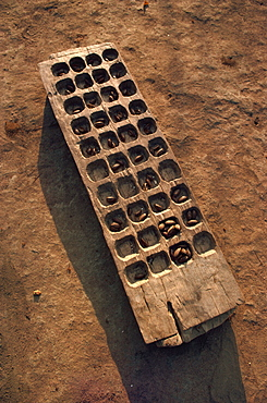Wooden gaming board (houri) and dried beads, Maridi village, Sudan, Africa