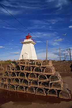 Fishing baskets and lighthouse on Prince Edward Island, Canada, North America