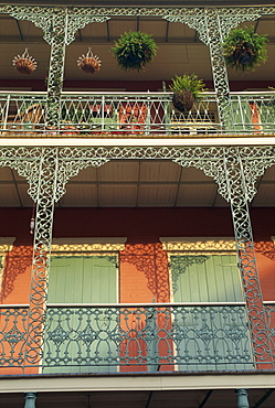 Detail of wrought iron and wooden shutters on balconies of buildings in the French Quarter of New Orleans, Louisiana, United States of America, North America