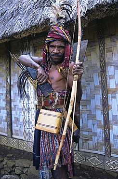 Abui tribal headhunter in warrior dress, Alor Island, eastern area, Indonesia, Southeast Asia, Asia