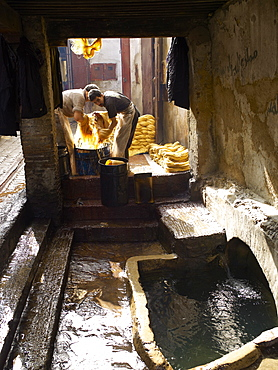 Men dyeing silk in the street, Fez, Morocco, North Africa, Africa