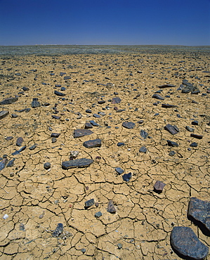 Cracked earth and rocks in the Outback of South Australia, Australia, Pacific