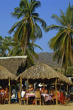 Tourists at a cafe on the beach at Acapulco, Mexico, North America