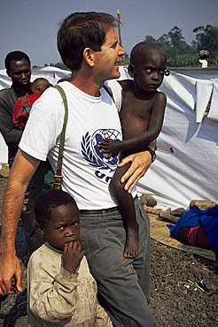 UNICEF representative with orphans, Goma, Zaire, Africa