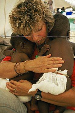Italian nurse in orphanage, Goma, Zaire, Africa