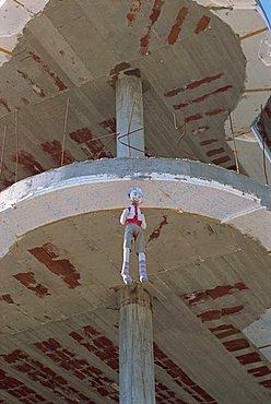 Stuffed dummy hung on building as good luck charm, Saranda, Albania, Europe