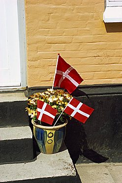 Danish flags outside a house in Aeroskobing, Aero, Denmark, Scandinavia, Europe