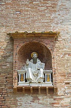 Entrance gate house, at the Benedictine Monastery famous for frescoes in cloisters depicting the life of St. Benedict, Monte Oliveto Maggiore, Tuscany, Italy, Europe