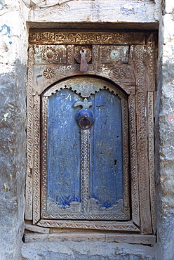 Close-up of a blue door in a carved wood frame in the old city area of the Babylonian town of Sana (the capital of north Yemen), Yemen, Middle East