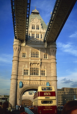 Detail of Tower Bridge, with double-decker bus passing through, London, England, Unnited Kingdom, Europe