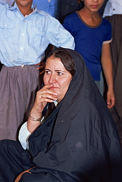 Head and shoulders portrait of a Kurdish woman at the Souk Erbil, Kurdistan, Iraq, Middle East