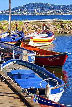 Old fishing boats, Etang de Thau Museum, Bouzigues, Thau basin, Sete town in the background, Herault, Languedoc, France, Europe