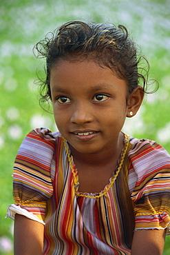 Head and shoulders portrait of a young Sri Lankan girl near Kandy, Sri Lanka, Asia